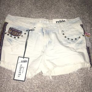 Jean shorts with embroidery details and studs